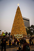 The colourful Hong Kong Christmas tree outside the Mandarin Hotel on Queen's Road Central, Hong Kong. The iconic Statue Square Christmas tree is 18 metres tall. (photo by Andrew Aitchison / In pictures via Getty Images)
