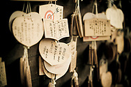 Prayers (Ema) at the Ninomiya Shrine in Kobe, Japan.  The shrine is located in the heart of downtown and offers a peaceful respite from the commotion of the city.