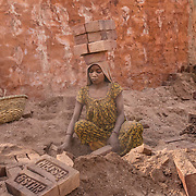 An Indian woman working in a bric factory. Mayapur, India - April 22nd 2013.