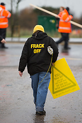 © Licensed to London News Pictures . 26/01/2014 . Salford , UK . A woman wearing a Frack Off hoody . Approximately 500 protesters march to an iGas fracking exploration site at Barton Moss , Salford , today (Sunday 26th January 2014) . They walk along the A57 road , blocking traffic as they do . A long term protest camp has been established on an access road leading to the site and today (26th January) protesters from other areas of the country travelled to the site to join with other protesters against fracking . Photo credit : Joel Goodman/LNP