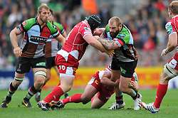 Harlequins prop Joe Marler is double-tackled in possession - Photo mandatory by-line: Patrick Khachfe/JMP - Tel: Mobile: 07966 386802 12/10/2013 - SPORT - RUGBY UNION - Twickenham Stoop - London - Harlequins V Scarlets - Heineken Cup