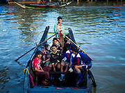 23 NOVEMBER 2017 - YANGON, MYANMAR: The crew of a fishing trawler comes to shore in a river taxi at the San Pya Fish Market. San Pya Fish Market is one of the largest fish markets in Yangon. It's a 24 hour market, but busiest early in the morning. Most of the fish in the market is wild caught but aquaculture is expanding in Myanmar and more farmed fresh water fish is being sold now than in the past.    PHOTO BY JACK KURTZ