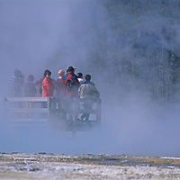 Tourists wait for a geyser to spout in Norris Geyser Basin, Yellowstone National Park, Wyoming