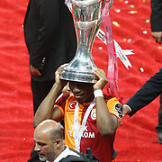 Galatasaray Tebily Didier Yves Drogba celebrate with the trophy after their Turkish Super League soccer match against Trabzonspor at Turk Telekom Arena stadium May 18, 2013.Galatasaray won the Turkish league title for the 19th time. Photo by TURKPIX