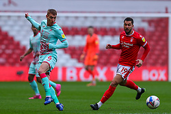 Jay Fulton of Swansea City passes the ball, chased by Miguel Angel Guerrero of Nottingham Forest  - Mandatory by-line: Nick Browning/JMP - 29/11/2020 - FOOTBALL - The City Ground - Nottingham, England - Nottingham Forest v Swansea City - Sky Bet Championship
