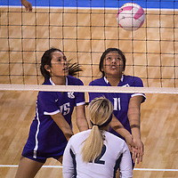 111314      Cayla Nimmo<br /> <br /> Kirtland Central Broncos, Morgan Farley (15) and Krystal Sheka (11) go for the ball in the State Championship Pool game held in Rio Rancho against Silver Thursday morning.