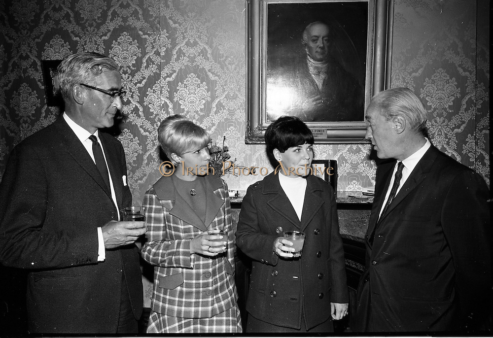 14/07/1967<br /> 07/14/1967<br /> 14 July/1967<br /> Miss Ireland-America visits Powers Distillery, John's Lane, Dublin. Pictured are (l-r): Mr John A. Ryan, Joint Managing Director, John Power and Son Ltd.; Miss Linda Addonizio, niece of Mayor of Newark; Miss Patricia McCoy, Miss Ireland-America and Mr. L. Behan, Adelphi Cinema, Dublin. Miss McCoy (21) was in Ireland for a week long visit having won her title in Newark, New Jersey.
