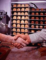 banker, insurance agent, baker, small business owner Bakery loaves of bread handshake