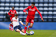 Preston North End forward Jacob Holland-Wilkinson (27) and Reading midfielder Josh Laurent (28) battle for possession  during the EFL Sky Bet Championship match between Preston North End and Reading at Deepdale, Preston, England on 24 January 2021.
