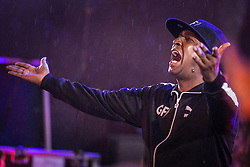 © Licensed to London News Pictures . 31/05/2015 . Manchester , UK . Grandmaster Flash ( Joseph Saddler ) eggs on the crowd as it starts to rain , during a performance of a DJ set in Albert Square in Manchester at the end of the first night of the Grillstock Festival . Photo credit : Joel Goodman/LNP