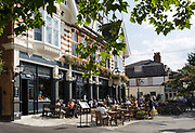 Summer drinkers enjoy a warm Sunday afternoon outside the newly refurbished Crown and Greyhound pub and morecently, an hotel in Dulwich Village, on 2nd September 2017, in south London, England. 20 new bedrooms are available for short-stays but the pub gets its name from two former pubs in Dulwich Village, The Crown, and The Greyhound, which were across the street from each other up to the 1890s. The Crown and Greyhound is a Grade II listed public house at 73 Dulwich Village.
