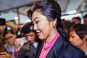 """09 JANUARY 2105 - BANGKOK, THAILAND: YINGLUCK SHINAWATRA, former Prime Minister of Thailand, walks to a waiting car after presenting her defense during her impeachment at the National Legislative Assembly. Thailand's military-appointed National Legislative Assembly began impeachment hearings Friday against former Prime Minister Yingluck Shinawatra. If she is convicted, she could be forced to stay out of politics for five years. During her defense, Yingluck questioned the necessity of her impeachment, saying, """"I was removed from office, the equivalent of being impeached, three times already, I have no position left to be impeached from."""" A decision on her impeachment is expected by the end of January.    PHOTO BY JACK KURTZ"""