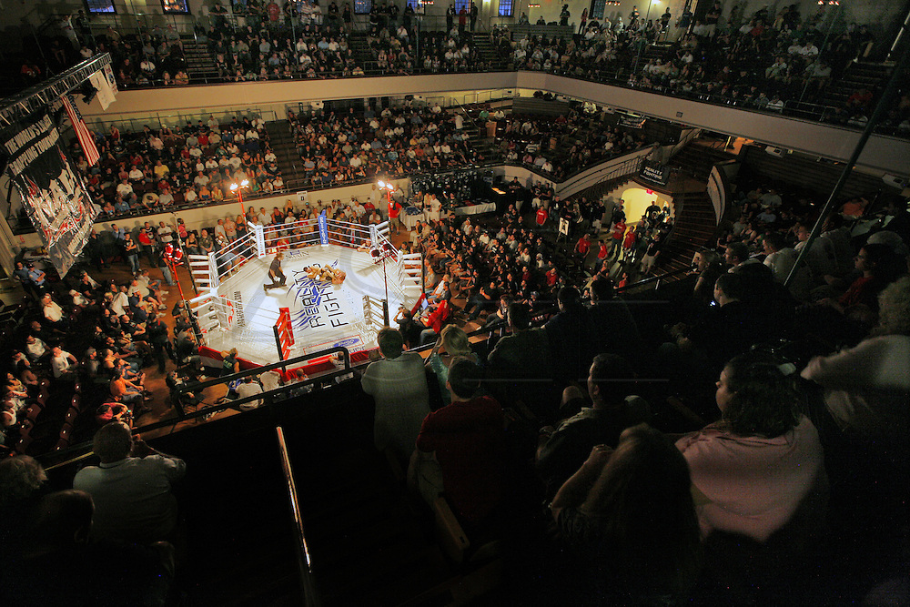 A full house looks on as fighters take to the ring for a match of Reality Fighting at Plymouth Memorial Hall in Plymouth, MA.