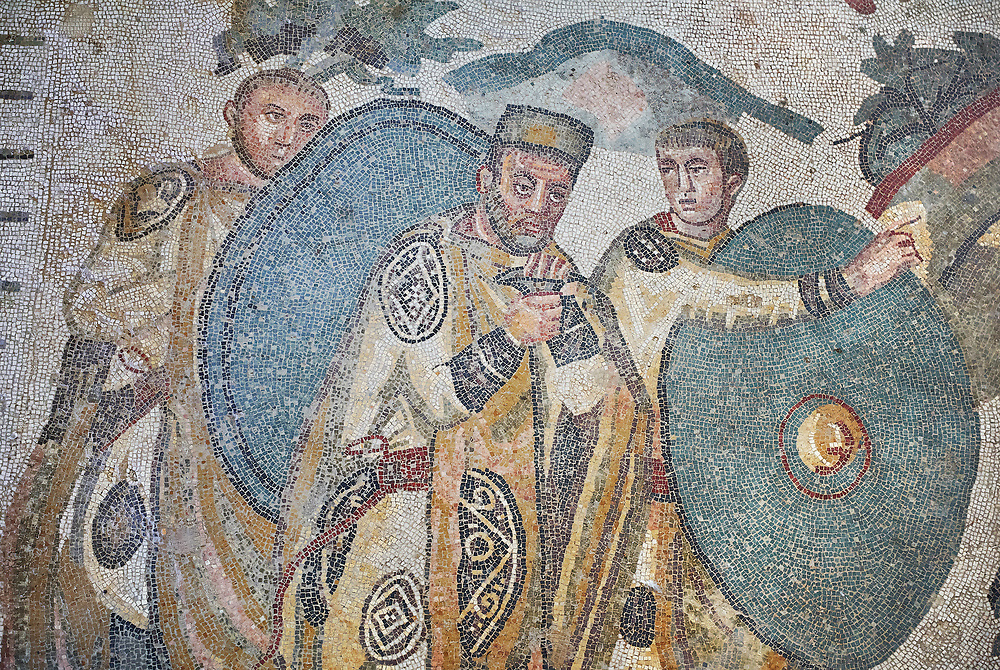 Ambulatory of the Great Hunt Roman mosaic, Emperor Maximianus watches the animal hunt, room no 28, at the Villa Romana del Casale, first quarter of the 4th century AD. Sicily, Italy. A UNESCO World Heritage Site.<br /> <br /> The Great Hunt ambulatory is around 60 meters long (200 Roman feet) and connects the master's northern apartments with the triclinium in the south. The door in the centre of the the Great Hunt ambulatory leads to audience hall. <br /> <br /> The Great Hunt Roman mosaic depicts African animals being hunted and put onto ships to be taken to the Colosseum. .<br /> <br /> If you prefer to buy from our ALAMY PHOTO LIBRARY  Collection visit : https://www.alamy.com/portfolio/paul-williams-funkystock/villaromanadelcasale.html<br /> Visit our ROMAN MOSAIC PHOTO COLLECTIONS for more photos to buy as buy as wall art prints https://funkystock.photoshelter.com/gallery/Roman-Mosaics-Roman-Mosaic-Pictures-Photos-and-Images-Fotos/G00008dLtP71H_yc/C0000q_tZnliJD08