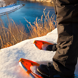 Snowshoes on a bluff overlooking the Merrimack River in Canterbury, New Hampshire.