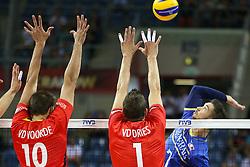07.09.2014, Krakow Arena, Krakau, POL, FIVB WM, Frankreich vs Belgien, Gruppe D, im Bild Kevin Tillie (FRA), Simon Van De Voorde (BEL), Bram Van Den Dries (BEL) // during the FIVB Volleyball Men's World Championships Pool D Match beween France and Belgium at the Krakow Arena in Krakau, Poland on 2014/09/07.<br /> <br /> ***NETHERLANDS ONLY***
