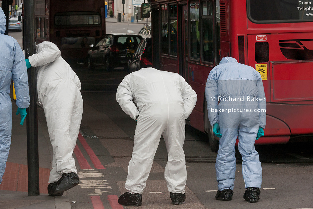 36 hours after the London Bridge and Borough Market terrorist attack, the capital returns to normality and Londoners return to their first day to work while Scenes of Crime Officers (SOCO) scour looking for more evidence, on Monday 5th June 2017, in the south London borough of Southwark, England. Seven people were killed and many others left with life-changing injuries - but the British spirit of defiance and to carry on with every day life, endures.