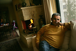 Jamil Rabah, a pollster and researcher is seen in his home in Ramallah, Palestinian Territories, Feb. 11, 2005. Jamil is part of a Palestinian middle and upper class who are likely to have prominent roles in the developing peace process.