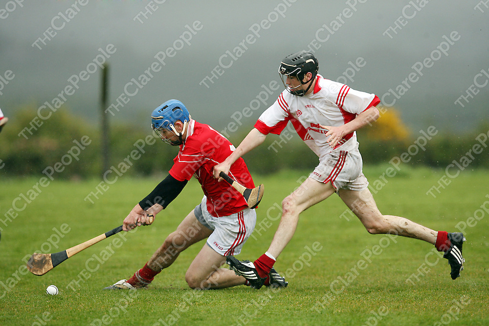 Corofin's Luke O' Loughlin tries to keep the ball away from Crusheen's Fergus Kennedy during their championship clash in Killanena on Sunday.<br /> Photograph by Yvonne Vaughan