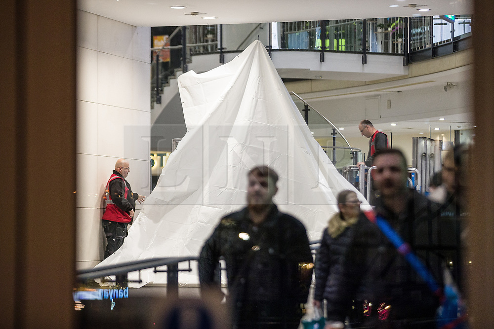 © Licensed to London News Pictures . 13/02/2020. Manchester, UK. Screens are erected around the centre , blocking views in , ahead of the exercise. Police stage a major terrorist incident as a training exercise , at the Arndale Shopping Centre in Manchester City Centre . Residents have been advised not to be concerned by the sound of loud bangs that might be heard overnight from within the closed-off venue . Photo credit: Joel Goodman/LNP