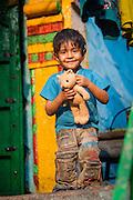 Indian boy with teddy bear (India)