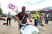 A group of XR drummers performs in Endeavour Square ahead of Banshees performance in London on Monday, Aug 31, ahead of their nationwide disruption demanding government obedience over the climate change solutions. (VXP Photo/ Vudi Xhymshiti)