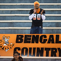 A Gallup Bengal fan claps for his team and shows his spirit with a large Bengal Country sign.