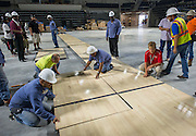 Workers lay down the floor at the new Delmar Fieldhouse, October 31, 2016.
