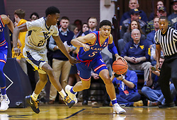 Jan 19, 2019; Morgantown, WV, USA; Kansas Jayhawks guard Quentin Grimes (5) dribbles up the floor during the first half against the West Virginia Mountaineers at WVU Coliseum. Mandatory Credit: Ben Queen-USA TODAY Sports