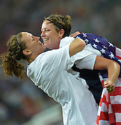 Wembley, Great Britain, USA Striker,  Abby WAMBACH, gets a hug from team mate Hope SOLO [Goalkeeper], as the USA Women's Football Team. grind out  a 2-1 victory, over Japan, to win the Olympic Gold Medal. <br /> 2012 London Olympic, Women's Football, Gold Medal Match at Wembley Stadium, USA vs Japan.  Thursday  09/08/2012 [Mandatory Credit: Peter Spurrier/Intersport Images]