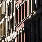 """Facades of early 20th century buildings in the """"Leather District"""" of Boston, Massachusetts"""