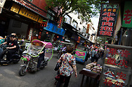 Street with people and tuktuk, Old Town Muslim quarters, Xian City, Shaanxi, China