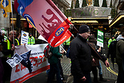 Union members at the N30 demonstration march protest in London pass the Savoy Hotel as the public sector strike over pensions, this disrupted schools, hospitals and other services.