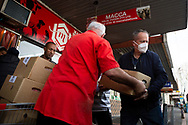Former Labor Leader Bill Shorten (R) is seen wearing a facemask as he helps load meat into a truck from Macca Halal Foods in Flemington to help feel the people affected by the housing commission tower lockdown during COVID-19 on 10 July, 2020 in Melbourne, Australia. Former Federal Labor Leader Bill Shorten, along with close allies at Trades Hall help deliver Halal meat, supplied by Macca Halal Foods to the locked down housing commission towers following a coronavirus outbreak detected inside the complex. Mr Shorten was able to use his high profile to ensure food was not turned away by police so that it would reach the residents inside. (Photo be Dave Hewison/ Speed Media)