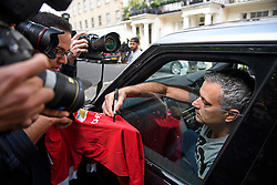© Licensed to London News Pictures. 27/05/2016. London, UK.  JOSE MOURINHO signs his first Manchester United FC shirt, owned by Steven Ribeiro, as he leaves his home in west London on the day he was officially announced as the new manager of Manchester United Football Club. Photo credit: Ben Cawthra/LNP