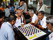 09 JULY 2017 - SINGAPORE: Men play Chinese checkers in the Chinatown section of Singapore.    PHOTO BY JACK KURTZ
