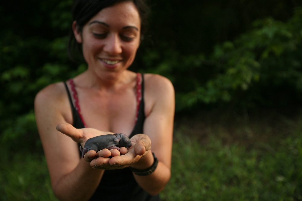 Pittsboro, NC - May 12: Danielle examines baby animals found on the farm at Circle Acres. (Photo by Logan Mock-Bunting)