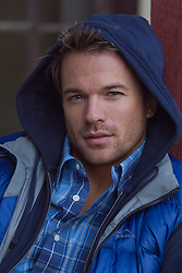 man with blue eyes wearing all blue clothing