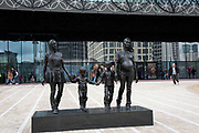 A Real Birmingham Family by Gillian Wearing in Birmingham, United Kingdom. A Real Birmingham Family is a public artwork and sculpture by Gillian Wearing, cast in bronze, and erected in Centenary Square, outside the Library of Birmingham, England, on 30 October 2014. It depicts two local sisters, each single mothers called Roma and Emma Jones, with their two children.