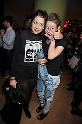 Left to right, PEACHES GELDOF and friend BILLIE at the St.Martins Lane Hotel 10th year bash held on 9th September 2009.