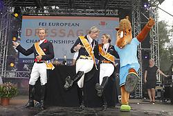 Podium Kür<br /> 1 Adelinde Cornelissen (NED)<br /> 2. Carl Hester (GBR) <br /> 3. Patrick Kittel (SWE)<br /> European Championships Dressage - Rotterdam 2011<br /> © Hippo Foto - Leanjo de Koster