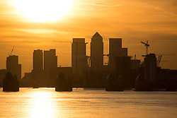 © Licensed to London News Pictures. 01/09/2016. The sun sets behind Canary Wharf on September 1st 2016 - the first day of meteorological autumn.  Credit: Rob Powell/LNP