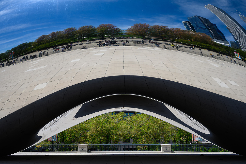 The Cloud Gate sculpture, often referred to as The Bean, creates a beautiful reflection of Chicago's skyline.