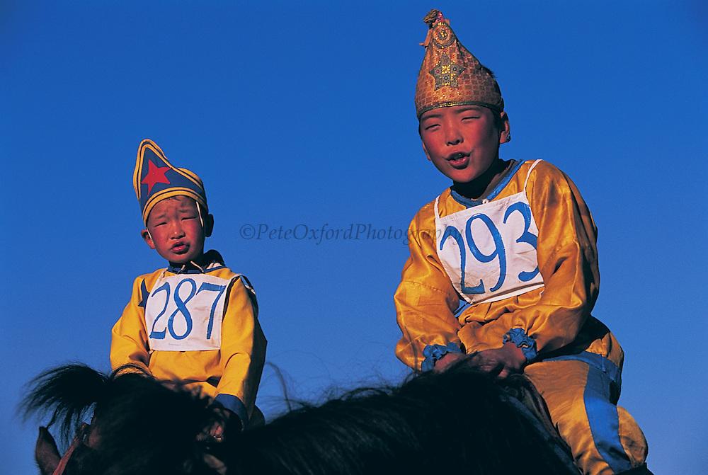Jockeys<br /> Naadam festival horse race<br /> Jockey's aged 4-12 years and most often girls<br /> Ulaanbaatar race track<br /> Mongolia
