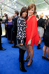 Left to right, CLAUDIA WINKLEMAN and FEARNE COTTON at the Glamour Women Of The Year Awards held in Berkeley Square, London on 8th June 2010.