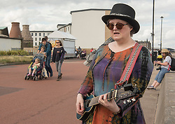 Back for the seventh year - the Portobello Big Beach Busk. Musicians of all sorts just turn up on the Prom, pick a spot from the many chalk circles drawn along the Prom and start playing! Also back for a second year is the sandcastle competition in front of the Baths. Pictured: Lorraine McCann <br /> <br /> <br /> © Jon Davey/ EEm