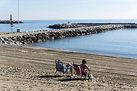 Spain, Malaga Province, Puerto Banus, two visitors, deck chairs, sunbathing, almost deserted beach, December, 2018, 201812100131<br /><br />Copyright Image from Victor Patterson, 54 Dorchester Park, <br />Belfast, UK, BT9 6RJ<br /><br />t1: +44 28 9066 1296 (from Rep of Ireland 048 9066 1296)<br />t2: +44 28 9002 2446 (from Rep of Ireland 048 9002 2446)<br />m: +44 7802 353836<br /><br />victorpattersonbelfast@gmail.com<br /><br />Please see my Terms and Conditions of Use at victorpatterson.com. It is IMPORTANT that you familiarise yourself with them.<br /><br />Images used on the Internet incur an additional cost and must be visibly watermarked i.e. © Victor Patterson within the body of the image and copyright metadata must not be deleted. Images used on the Internet have a size restriction of 4kbs and are chargeable at rates available at victorpatterson.com.<br /><br />This image is available only for the use of the download recipient i.e. television station, newspaper, magazine, book publisher, etc, and must not be passed on to any third party. It is also downloaded on condition that each and every usage is notified within 7 days to victorpattersonbelfast@gmail.com<br /><br />The right of Victor Patterson (or the named photographer) to be identified as the author is asserted in accordance with The Copyright Designs And Patents Act (1988). All moral rights are asserted.