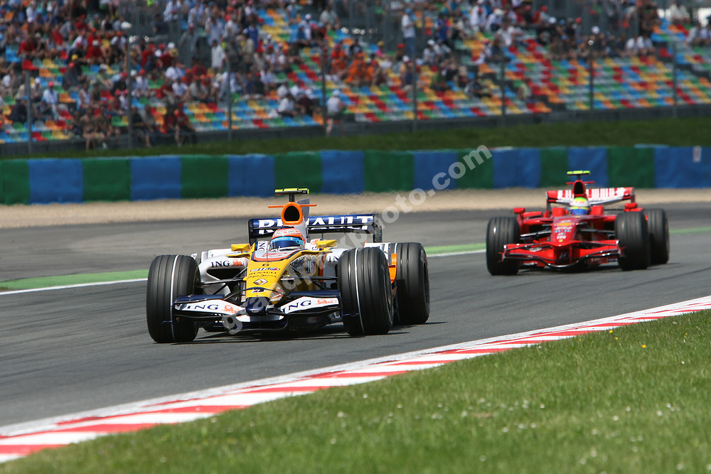 Nelson Piquet Jr (Renault) leads Felipe Massa (Ferrari) during qualifying for the 2008 French Grand Prix in Magny-Cours. Photo: Grand Prix Photo