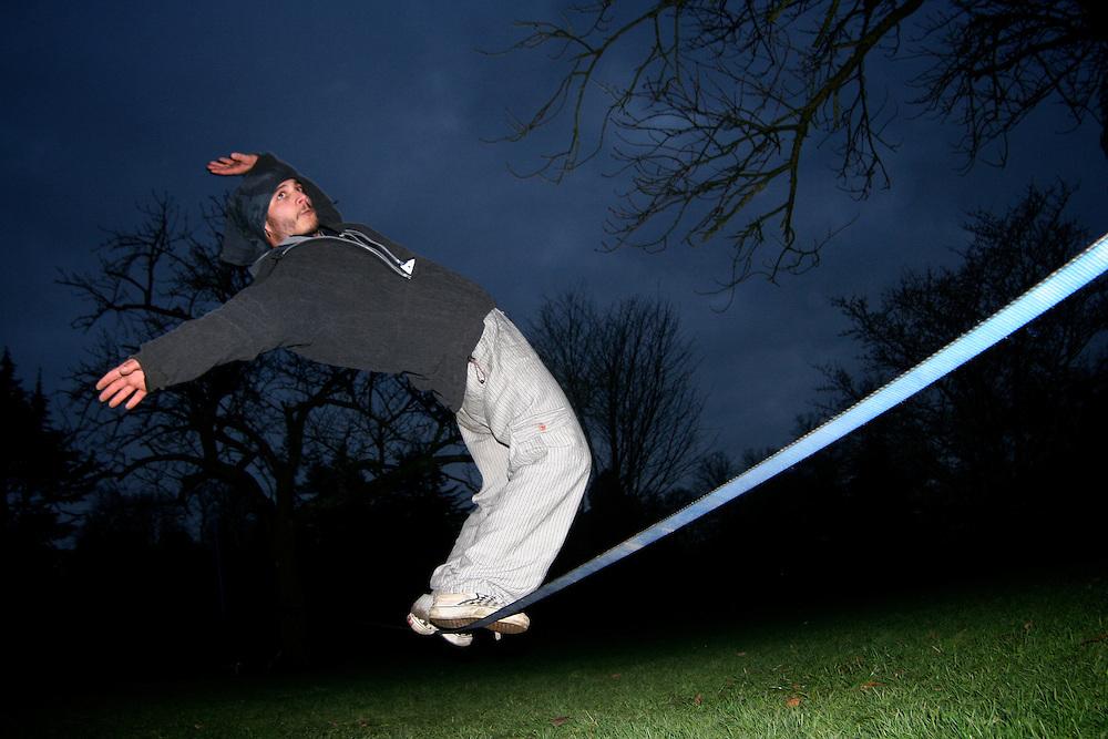 Slackline PT athlete Francisco Filipe, slacklining in Bute park during a Slack Trip in the U.K. Here, showing off some surf line tricks.