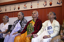 Group of elderly women taking part in meditation section of exercise class,